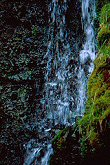 Waterfall photographed at a slow shutter speed, photograph by Brent VanFossen