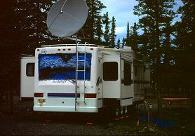 We found this huge trailer rig in Alaska with satellite TV and numerous slideouts, photograph by Lorelle VanFossen