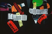 Photo of our suitcase tags after arrival in Israel