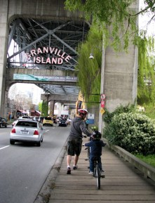 vancouver bc granville island adult with child on bike entrance by lorelle vanfossen