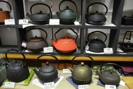 Metal Japanese Tea pots in shop - Japan - photography by Brent VanFossen.
