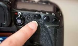 Camera Lens: AF Button