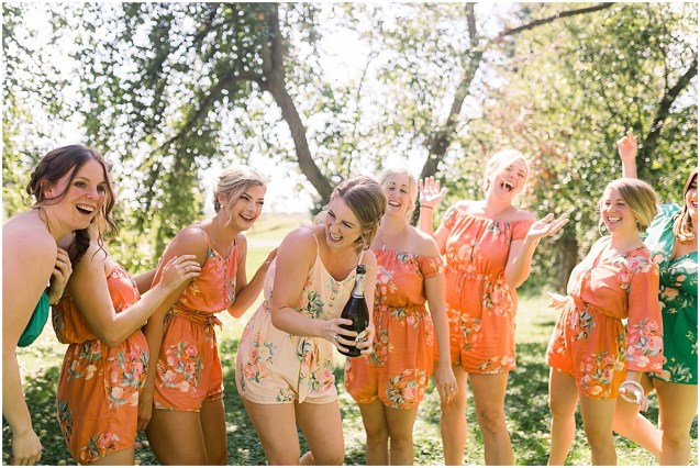 Bride and Bridesmaids popping champagne at Terra Nue Farm