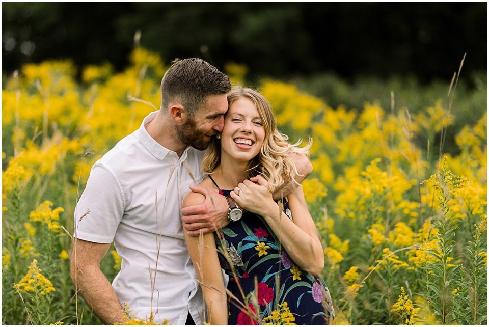 Trendy Downtown Minneapolis Engagement Session in a field at Boom Island Park