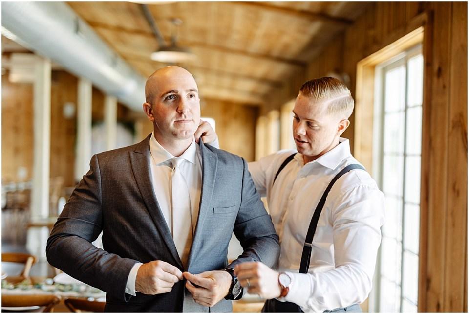 groom getting ready at Almquist Farm MN