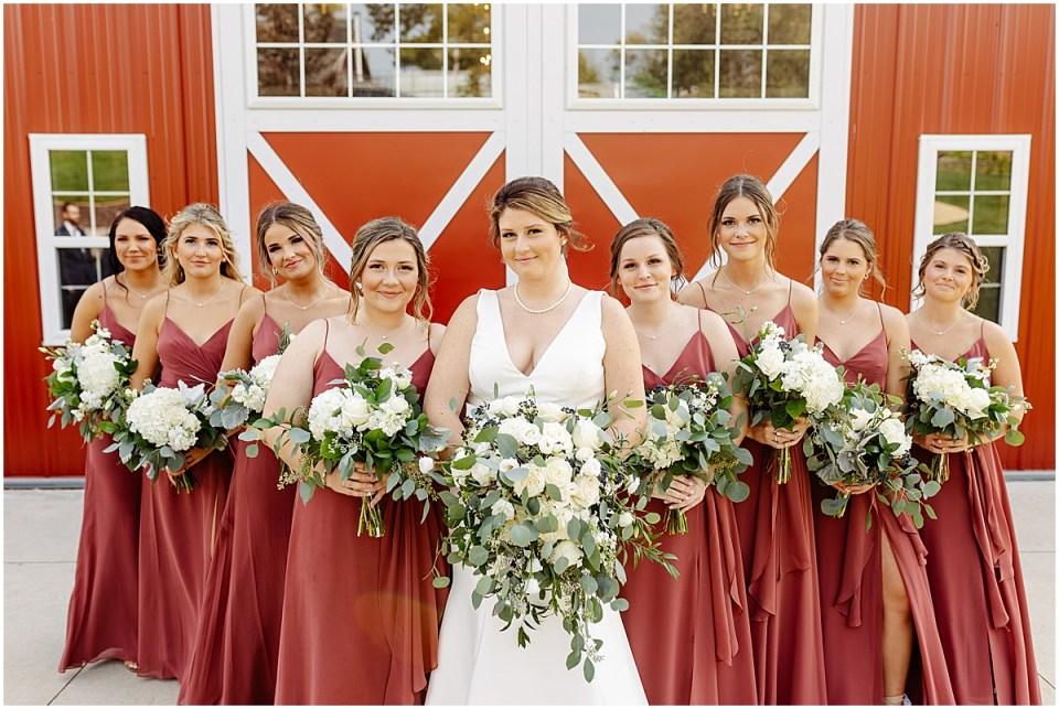 bridal party posing at red barn farm