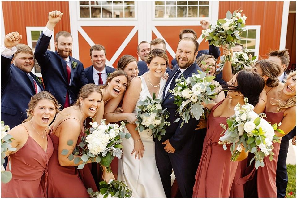 joyful bridal party at red barn farm