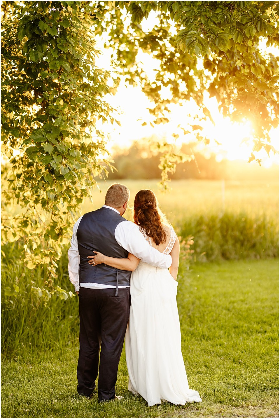 Husband and Wife Sunset Portraits on their wedding day