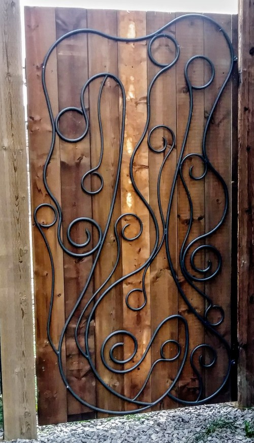 iron art gate mounted on wood