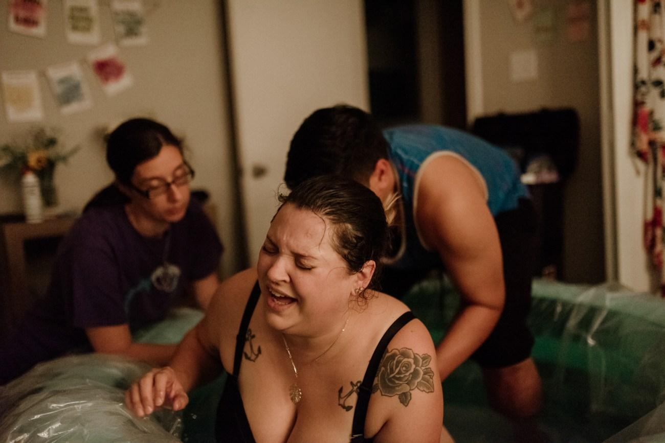 Virginia Beach woman giving birth.  Documentary birth photography session.