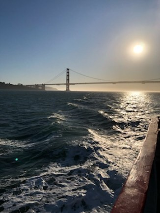 The romantic view of the Golden Gate Bridge at sunset on our bay boat trip.
