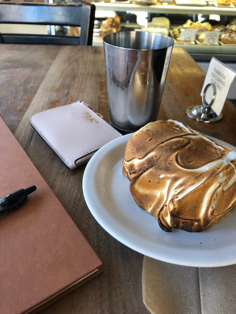 Eating lemon meringue cake and enjoying the afternoon sun at Tartine Bakery.