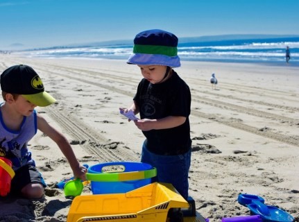 Unloading the sand toy bucket. So many new things to play with!