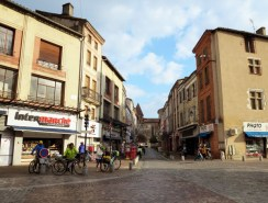 Navigating the busy streets of Moissac.