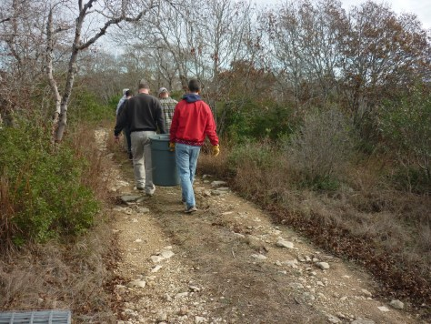 Carrying mulch to the trail