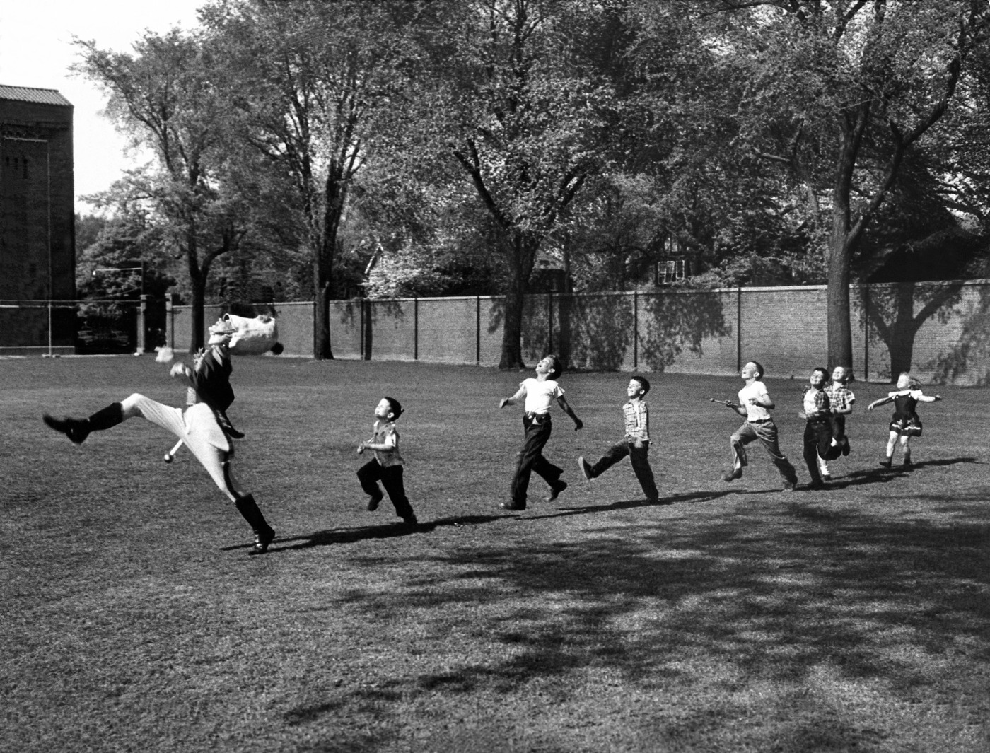 ten moments when time stood still campari sofa uniformed drum major for the univ of mi ing band practicing his high kicking prance as he leads a line of seven admiring children who are all trying
