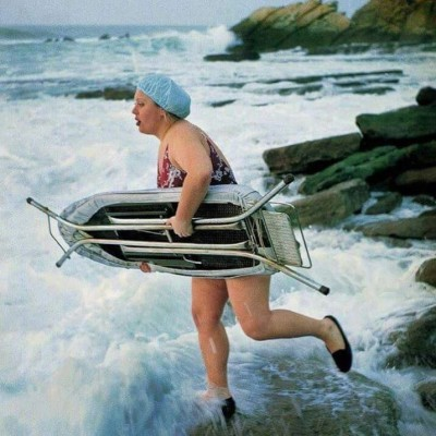 Woman surfing with ironing board
