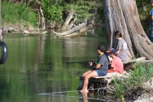 3 people fishing in Medina River