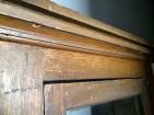 Detail of the cabinet's original wood grain.