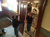 Parlor pocket doors being removed from the wall for the first time in more than 100 years.