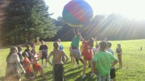 sunny-day-and-kids-playing-with-big-ball
