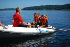 Campers in row boat on Puget Sound