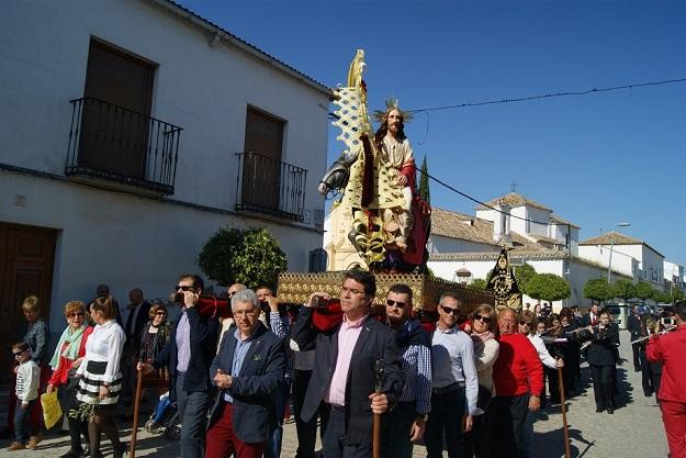La procesión de la Borriquita desfiló por las calles de Lopera.