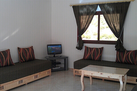 Camping Aourir – A living room at the Apartments at the Campsite which you can rent