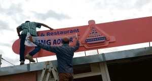 New restaurant nameplate on the roof of the restaurant