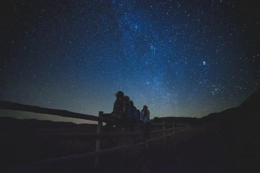 star gazing night sky while camping
