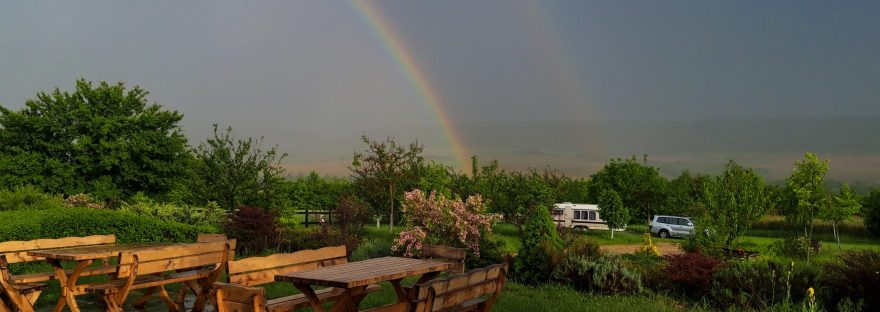 double rainbow in the valley of the campsite