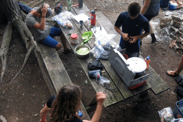 Image of explorers preparing dinner  during Expedition Champlain, one of the Lake Champlain Maritime Museum's summer expeditions.
