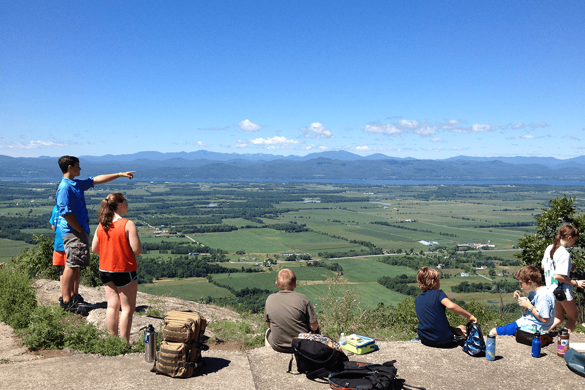 Image of kids having lunch on a mountain top. LAC Summer Camps.