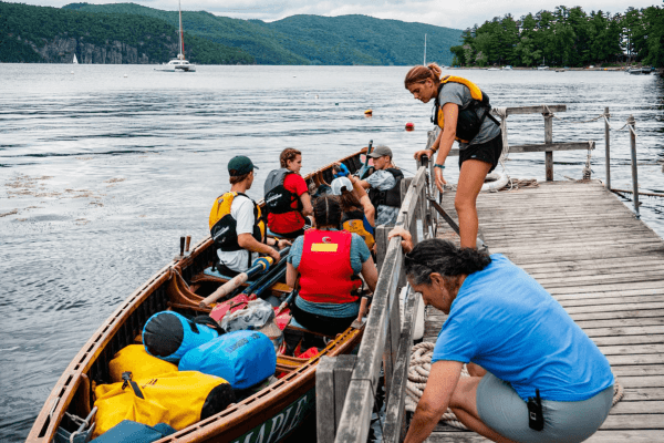 Image of campers and staff preparing to launch a gig  during Expedition Champlain, one of the Lake Champlain Maritime Museum's summer expeditions.