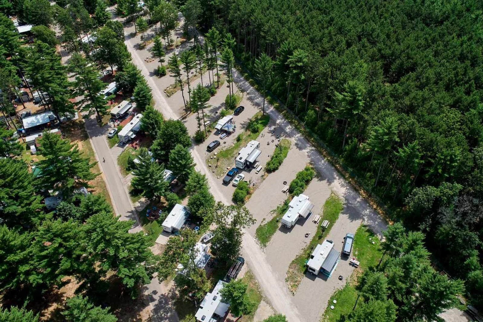 Aerial view of campground with parked trailers