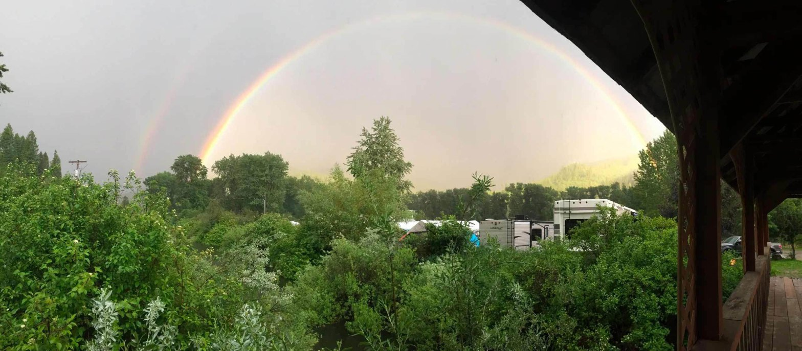 Rainbow over tree covered town