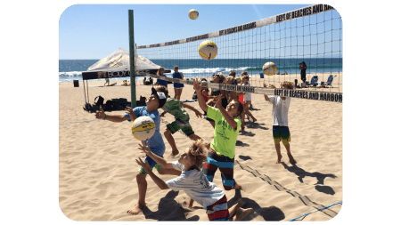 Groms playing volleyball at Camp Volley