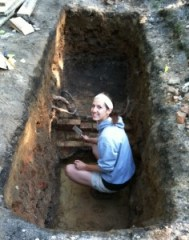 Katy working on cleaning up the trench with the plaster floor from Saints' Rest
