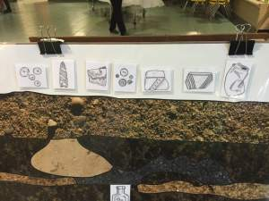 Close up of stratigraphy game. Artifacts drawn by Katy Meyers
