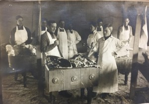 Students butcher meat, early 1900s. Image courtesy of MSU Archives & Historical Collections - Scrapbook #45