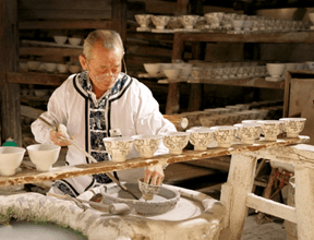 Making porcelain vessels in modern Jingdezhen, China. Image Source