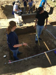 Kaleigh and Josh map a level floor.