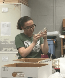 Desiree examines a bottle from the Brody/Emmons complex.