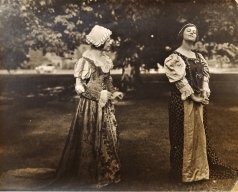 "Two students performing The Merry Wives of Windsor by Shakespeare in ""The Forest of Arden"" on campus in 1922. Photo courtesy of MSU Special Collections, originally in W.G. Butt's Master's Thesis."