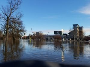 Flooding over Red Cedar Road with Spartan Stadium in the background. Image Source