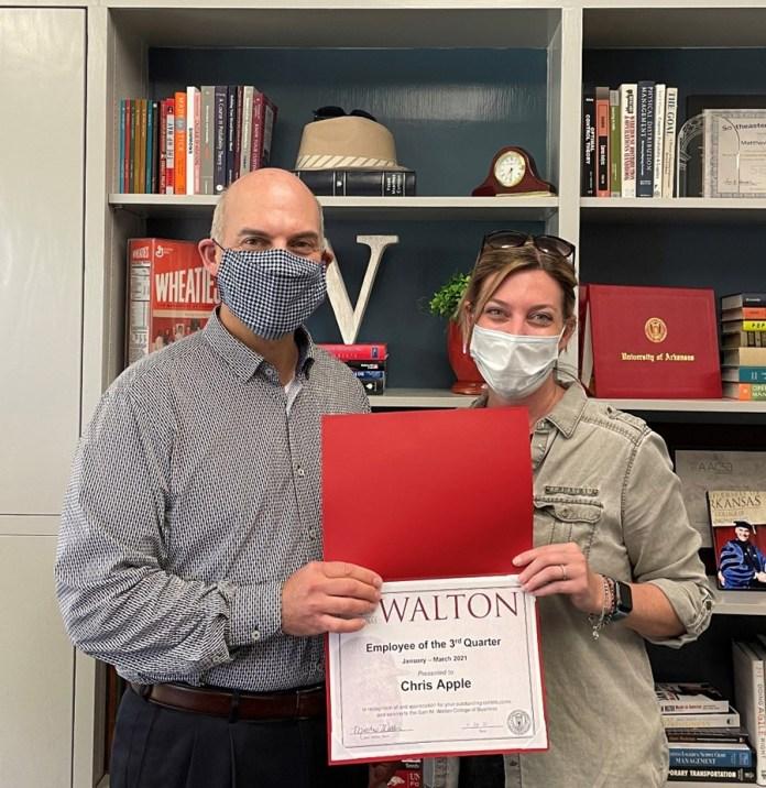 Dean Matt Waller recognizes Christine Apple as the Employee of the Third Quarter for Walton College.
