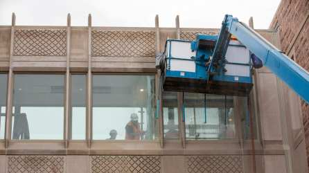 February 2019: Workers test watertightness of windows on bridge between Jubel Hall and Whitaker Hall.