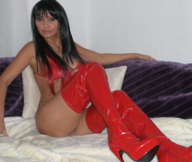 Long Legged Brunette Milf Shows Off Her Curves In Red Thigh High Boots