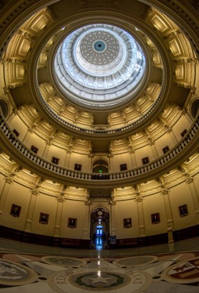 Looking up from Capitol rotunda while streaks of doorlight dash from hallway doors to illuminate the center