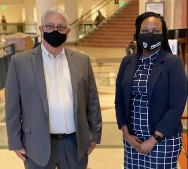 Candice Houston, Aldine AFT and Roy Sanchez from HOPE Local 1 stand with masks ready to testify at Capitol against SB 1